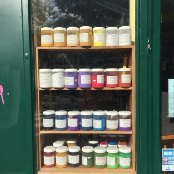 A rainbow of paints in the window
